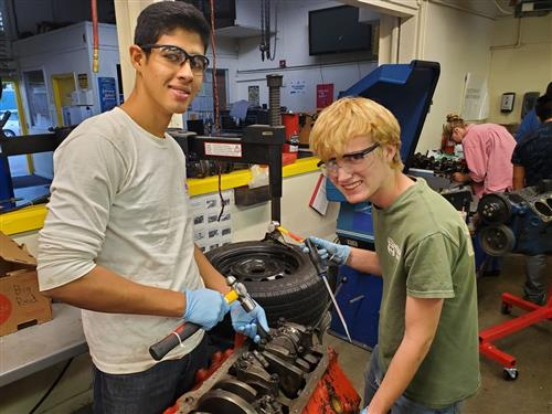Two students with tools in hand